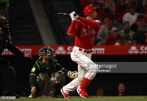 Shohei Ohtani of the Los Angeles Angels of Anaheim watches the ball go over the center field wall for a solo homerun during the second inning of the...