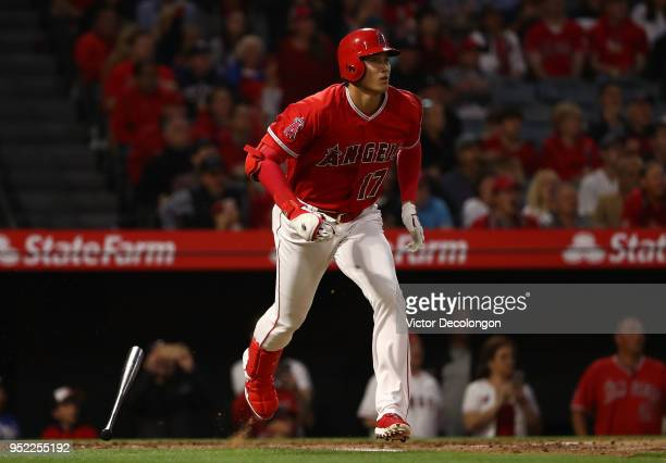 Shohei Ohtani of the Los Angeles Angels of Anaheim watches the ball leave the park for a solo homerun on his way to first base in the second inning...
