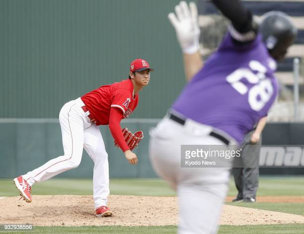 Shohei Ohtani of the Los Angeles Angels pitches during a spring training game against the Colorado Rockies in Tempe Arizona on March 16 2018 ==Kyodo