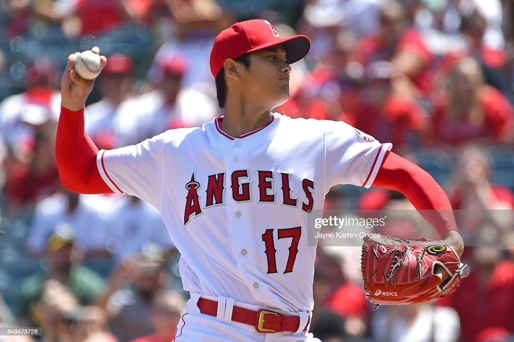 Shohei Ohtani #17 of the Los Angeles Angels pitches in the first inning of the game against the Oakland Athletics at Angel Stadium on April 8, 2018 in Anaheim, California.