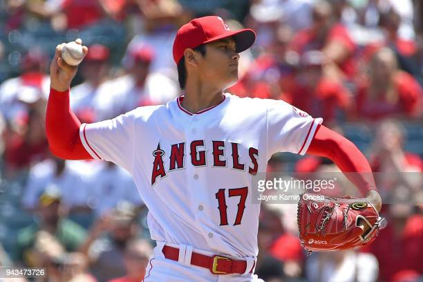 Shohei Ohtani of the Los Angeles Angels pitches in the first inning of the game against the Oakland Athletics at Angel Stadium on April 8 2018 in...