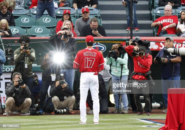 Shohei Ohtani of the Los Angeles Angels poses for photos after being awarded the American League Rookie of the Month for April ahead of a match...