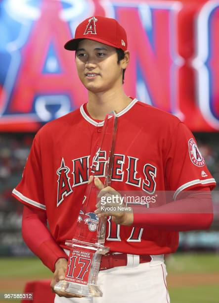 Shohei Ohtani of the Los Angeles Angels poses with his trophy for the American League Rookie of the Month for April in Anaheim California ahead of a...