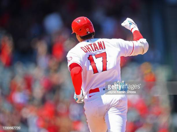 Shohei Ohtani of the Los Angeles Angels pumps his fist as he rounds the bases after hitting a two-run home run in the fifth inning of the game...