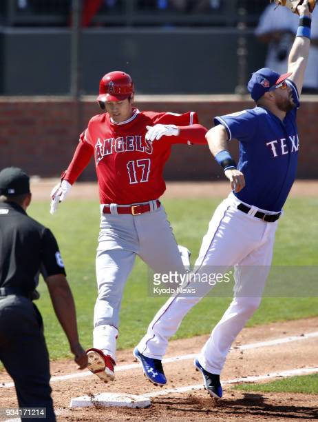 Shohei Ohtani of the Los Angeles Angels reaches first base on an error by Texas Rangers second baseman Jurickson Profar in the second inning of a...