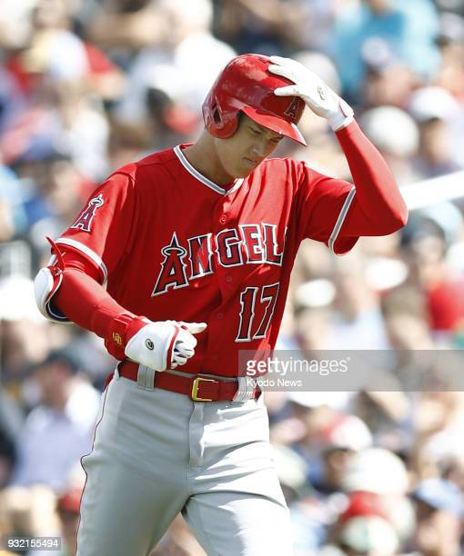 Shohei Ohtani of the Los Angeles Angels reacts after flying out against the Cleveland Indians in Goodyear Arizona on March 14 2018 ==Kyodo