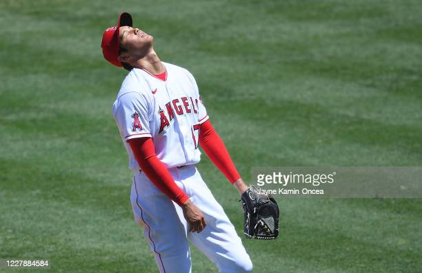 Shohei Ohtani of the Los Angeles Angels reacts after giving up a bases loaded walk scoring Michael Brantley of the Houston Astros in the second...