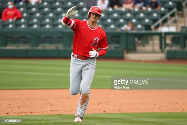 Shohei Ohtani of the Los Angeles Angels reacts after hitting a fly out to end the fifth inning against the Texas Rangers during the MLB spring...
