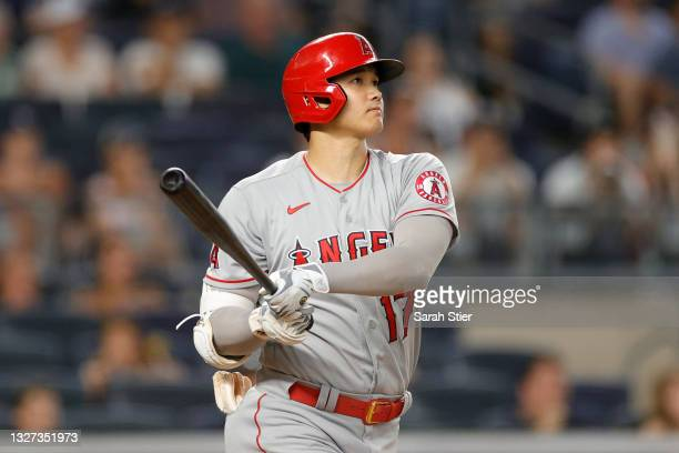 Shohei Ohtani of the Los Angeles Angels reacts after hitting a home run during the seventh inning against the New York Yankees at Yankee Stadium on...