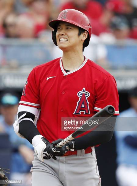 Shohei Ohtani of the Los Angeles Angels reacts after striking out in the second inning of a spring training game against the Seattle Mariners on...
