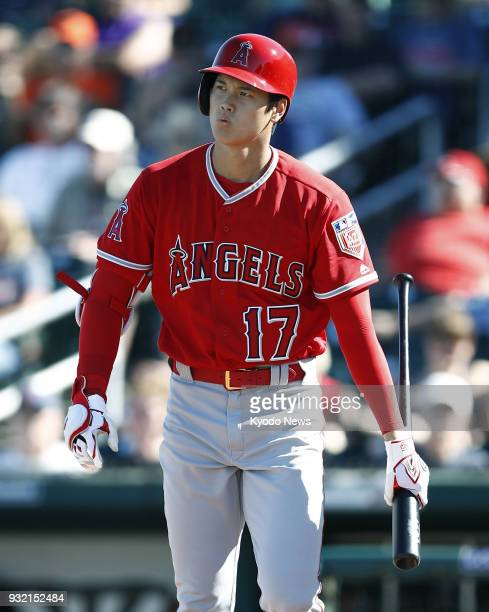 Shohei Ohtani of the Los Angeles Angels reacts after striking out against the Cleveland Indians in Goodyear Arizona on March 14 2018 ==Kyodo