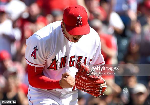 Shohei Ohtani of the Los Angeles Angels reacts after striking out the final batter of the seventh inning of the game against the Oakland Athletics at...