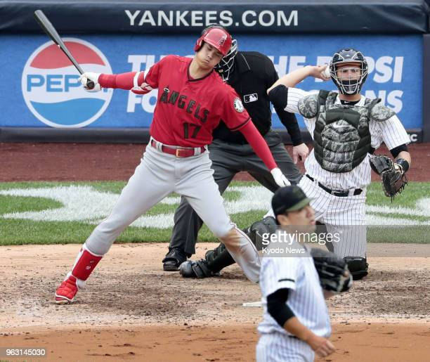 Shohei Ohtani of the Los Angeles Angels reacts after whiffing against Masahiro Tanaka of the New York Yankees during the sixth inning of a game at...