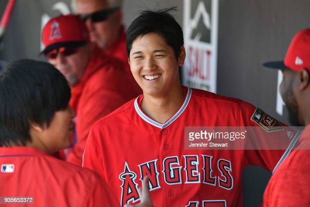 Shohei Ohtani of the Los Angeles Angels reacts in the dugout during the spring training game against the Arizona Diamondbacks at Salt River Fields at...