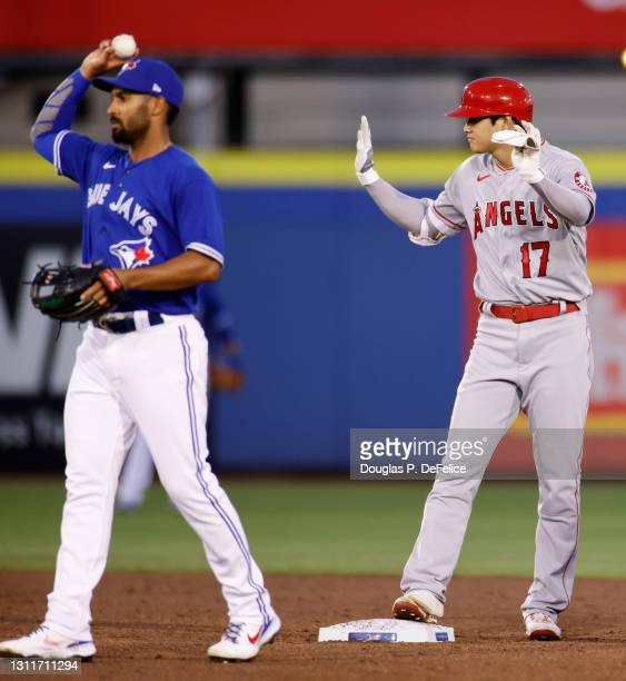 Shohei Ohtani of the Los Angeles Angels reacts second base after hitting a three run rbi double during the second inning against the Toronto Blue...
