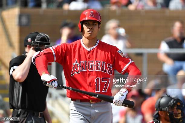 Shohei Ohtani of the Los Angeles Angels reacts while at bat in the fourth inning of the spring training game against the Arizona Diamondbacks at Salt...