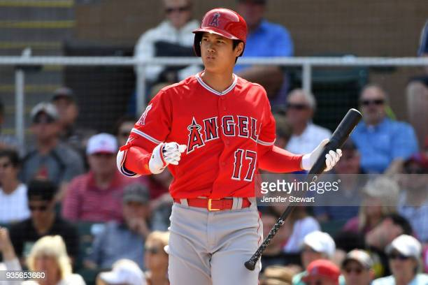 Shohei Ohtani of the Los Angeles Angels reacts while at bat in the second inning of the spring training game against the Arizona Diamondbacks at Salt...