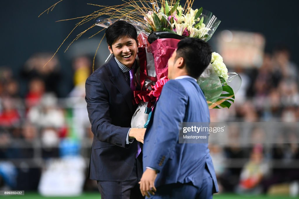 Shohei Ohtani of the Los Angeles Angels receives a flower bunch during his farewell event at Sapporo Dome on December 25, 2017 in Sapporo, Hokkaido, Japan.