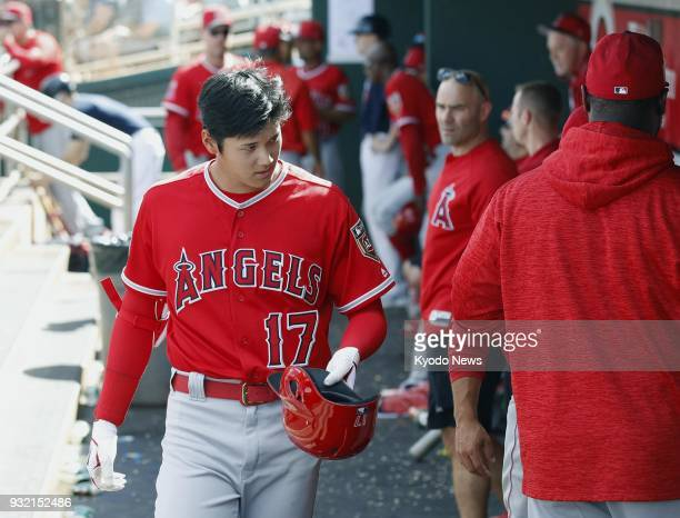 Shohei Ohtani of the Los Angeles Angels returns to the dugout after flying out against the Cleveland Indians in Goodyear Arizona on March 14 2018...