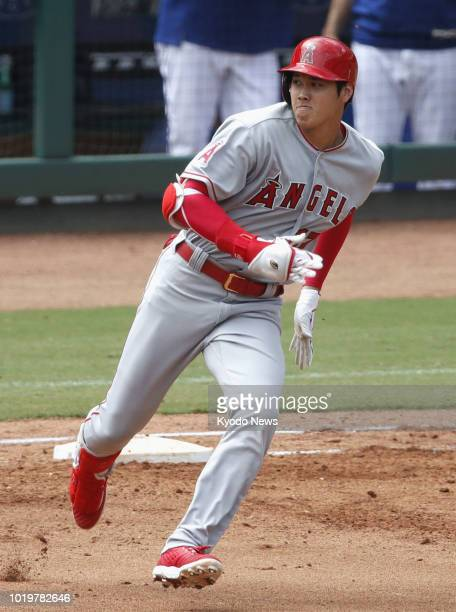 Shohei Ohtani of the Los Angeles Angels rounds first base after hitting a double during the fourth inning of the team's 42 loss to the Texas Rangers...