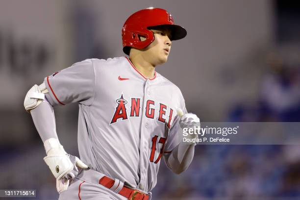 Shohei Ohtani of the Los Angeles Angels rounds the bases after hitting a solo home run to center field during the fifth inning against the Toronto...