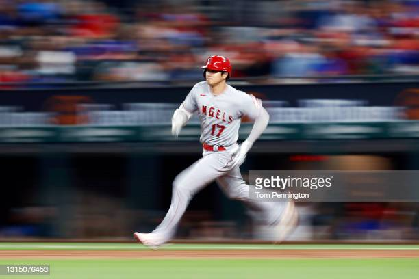 Shohei Ohtani of the Los Angeles Angels rounds the bases after hitting a double against Dane Dunning of the Texas Rangers in the top of the second...