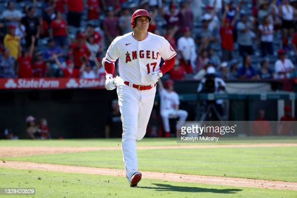 Shohei Ohtani of the Los Angeles Angels runs around the bases after his two run home run during the ninth inning against the Seattle Mariners at...