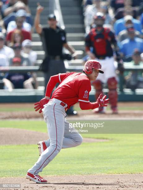 Shohei Ohtani of the Los Angeles Angels runs from second to third base against the Cleveland Indians in Goodyear Arizona on March 14 2018 ==Kyodo