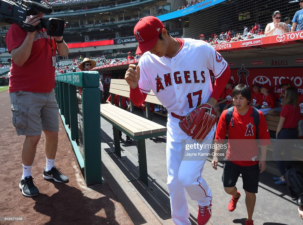 Shohei Ohtani #17 of the Los Angeles Angels runs on to the field to warm up before the start of the game against the Oakland Athletics at Angel Stadium on April 8, 2018 in Anaheim, California.
