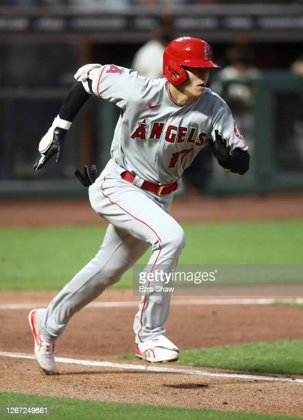 Shohei Ohtani of the Los Angeles Angels runs to first base after he hit a ground ball back to the pitcher in the fourth inning against the San...
