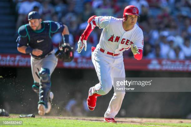 Shohei Ohtani of the Los Angeles Angels runs to first base on a passed ball 3rd strike in the 8th inning against the Seattle Mariners at Angel...