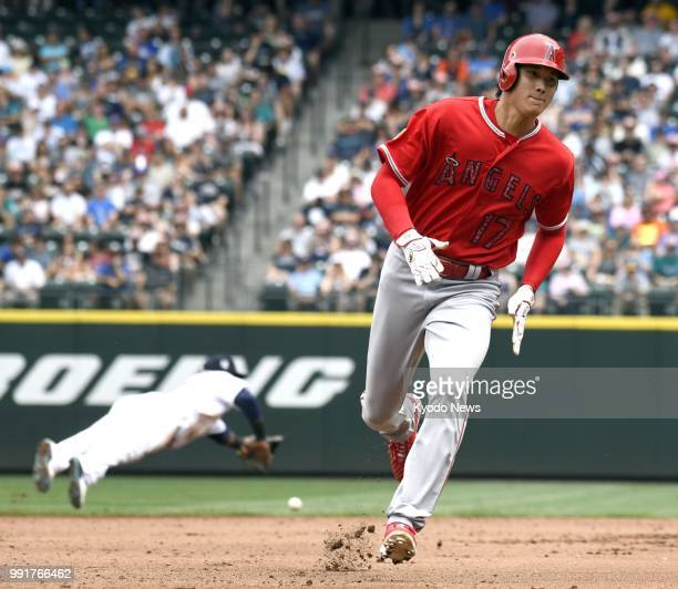 Shohei Ohtani of the Los Angeles Angels runs to home plate on a single hit by Kole Calhoun to score during the fourth inning of a 74 win against the...
