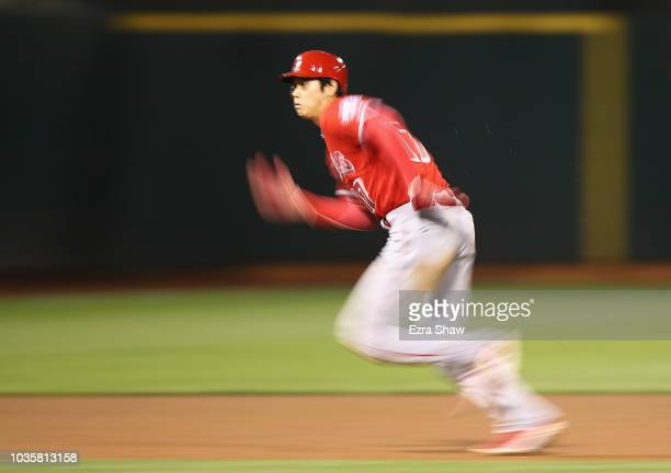 Shohei Ohtani of the Los Angeles Angels runs to third base in the eighth inning against the Oakland Athletics at Oakland Alameda Coliseum on...