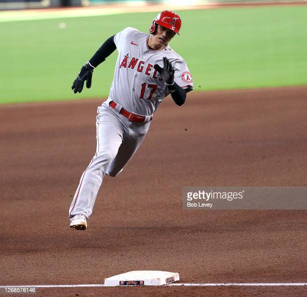 Shohei Ohtani of the Los Angeles Angels scores on a single by Jason Castro in the fifth inning against the Houston Astros during game one of a...