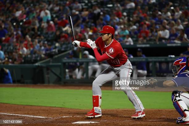 Shohei Ohtani of the Los Angeles Angels singles against the Texas Rangers in the second inning at Globe Life Park in Arlington on September 5 2018 in...