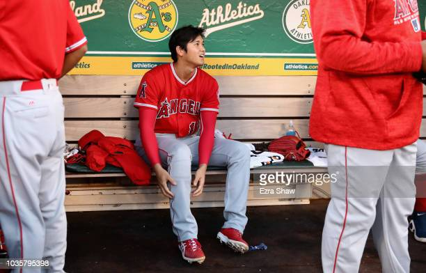 Shohei Ohtani of the Los Angeles Angels sits in the dugout before their game against the Oakland Athletics at Oakland Alameda Coliseum on September...