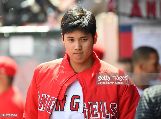 Shohei Ohtani of the Los Angeles Angels sits in the dugout during the game against the Oakland Athletics at Angel Stadium on April 8 2018 in Anaheim...