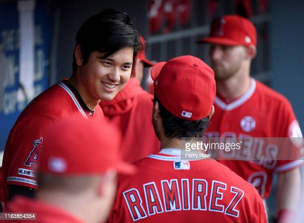 Shohei Ohtani of the Los Angeles Angels smiles in the dugout before the game against the Los Angeles Dodgers at Dodger Stadium on July 23, 2019 in...