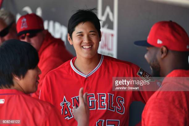 Shohei Ohtani of the Los Angeles Angels smiles in the dugout during the spring training game against the Arizona Diamondbacks at Salt River Fields at...