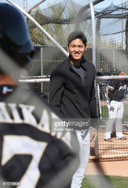 Shohei Ohtani of the Los Angeles Angels speaks to his former teammate Hokkaido Nippon Ham Fighter Haruki Nishikawa during the Japanese team's...