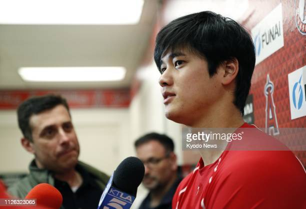 Shohei Ohtani of the Los Angeles Angels speaks to reporters after a workout at the club's spring training complex in Tempe Arizona on Feb 20 2019...