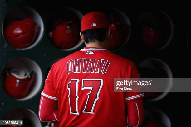 Shohei Ohtani of the Los Angeles Angels stands in the dugout before their game against the Oakland Athletics at Oakland Alameda Coliseum on September...