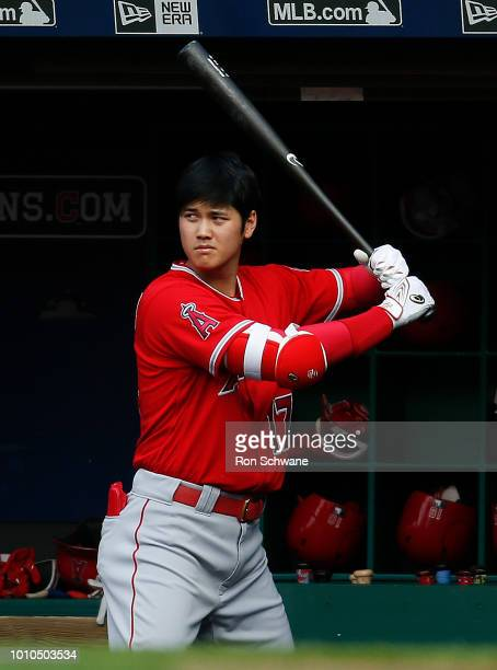 Shohei Ohtani of the Los Angeles Angels stands in the dugout during the first inning of a game against the Cleveland Indians at Progressive Field on...