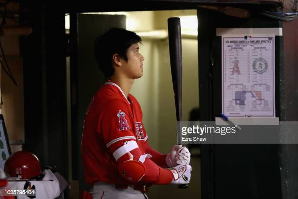 Shohei Ohtani of the Los Angeles Angels stands in the dugout during their game against the Oakland Athletics at Oakland Alameda Coliseum on September...