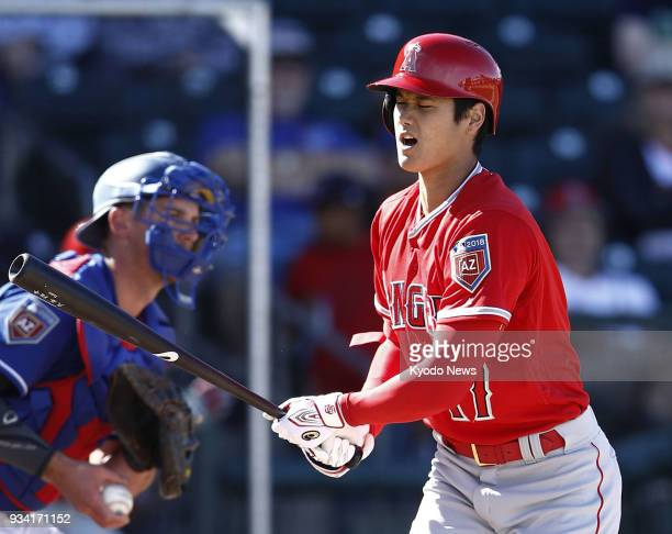 Shohei Ohtani of the Los Angeles Angels strikes out in the eighth inning of a spring training game against the Texas Rangers in Surprise Arizona on...