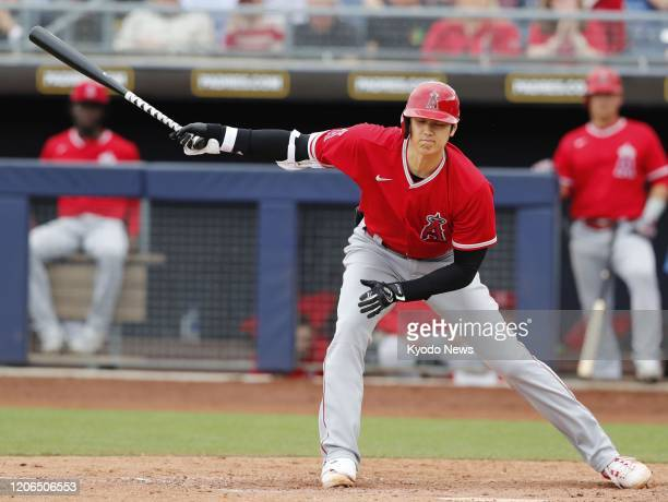 Shohei Ohtani of the Los Angeles Angels strikes out in the seventh inning of a spring training game against the Seattle Mariners on March 10 in...