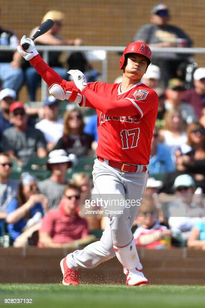 Shohei Ohtani of the Los Angeles Angels swings at a pitch in the fourth inning of the spring training game against the Arizona Diamondbacks at Salt...