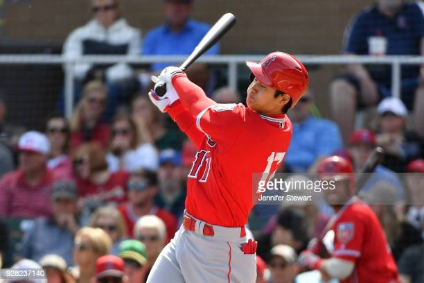 Shohei Ohtani of the Los Angeles Angels swings at a pitch in the second inning of the spring training game against the Arizona Diamondbacks at Salt...