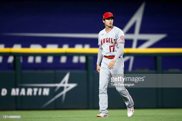 Shohei Ohtani of the Los Angeles Angels takes the field during pregame warmups prior to taking on the Texas Rangers at Globe Life Field on April 27,...