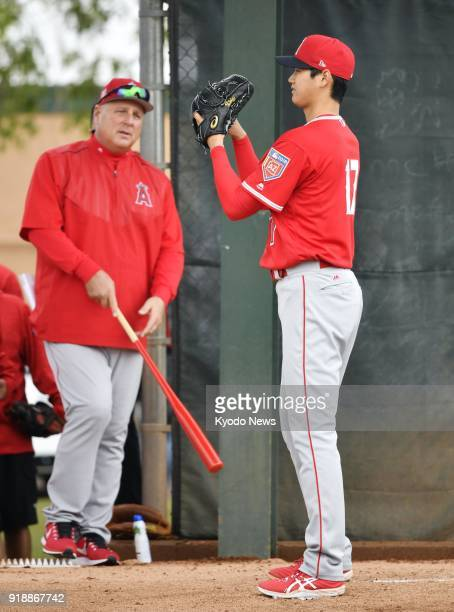 Shohei Ohtani of the Los Angeles Angels throws in the bullpen at the club's spring training site in Tempe Arizona on Feb 15 as manager Mike Scioscia...